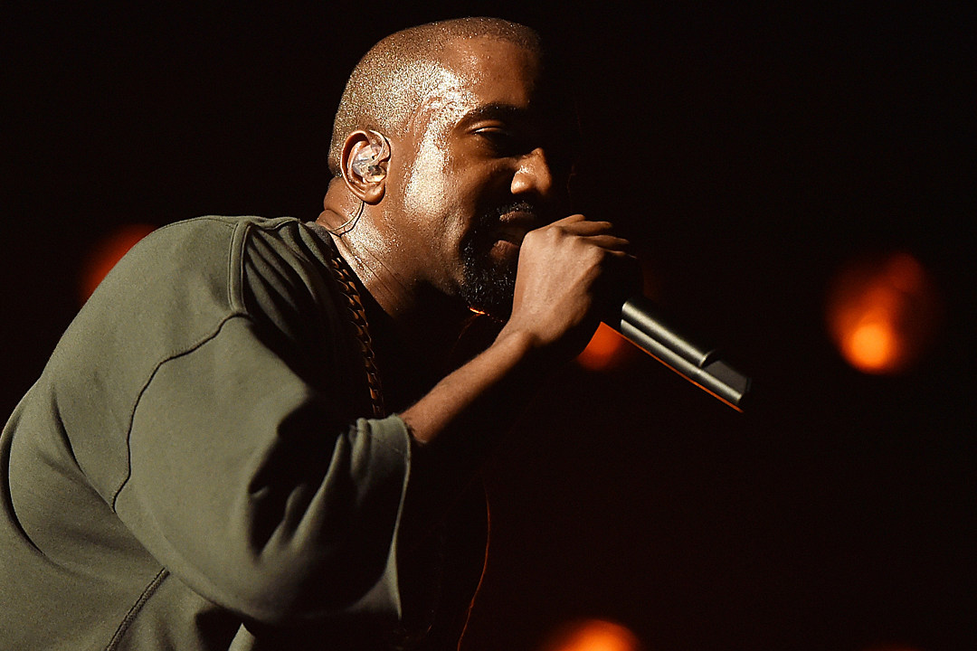 Kanye West performs onstage at the 2015 iHeartRadio Music Festival ...