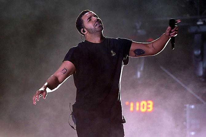 rapper tattoo guessing Drake